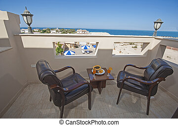 View from apartment balcony over tropical ocean horizon
