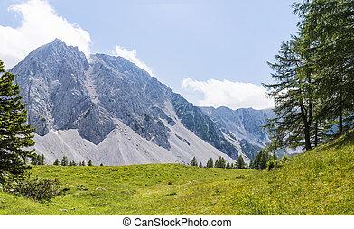 View from Austria to mountain range Karawanks with mountain...