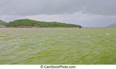 View from Azure Sea to Tourist Motorboat Mooring at Pier -...