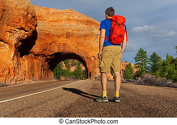 View from below of man on road near Red canyon