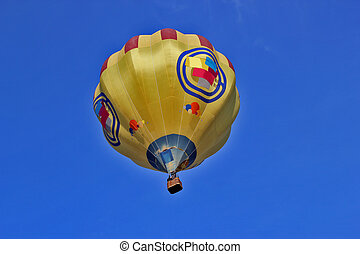 View from below on a balloon against the blue sky