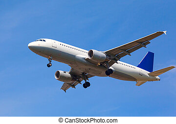 white jet passenger aircraft - view from below on the white...
