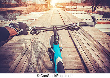 View from bikers eyes. riding on the bridge