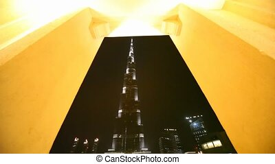 View from Burj Dubai Lake Bridge on skyscraper Burj Khalifa at night in Dubai, UAE.