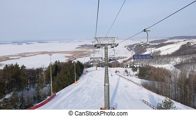 View from cabin of cable car on sky resort at sunny winter...