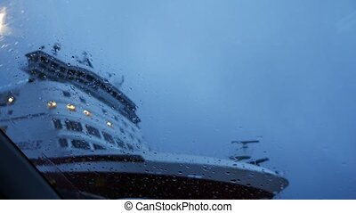 View from car on ferry ship with raindrops