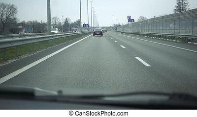 View from car to interurban high speed traffic - Car POV...