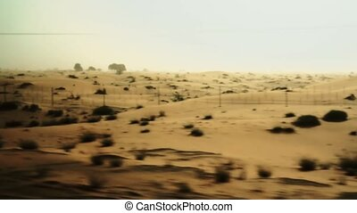 View from car window to desert. - View from car window to...