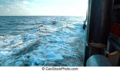 View from cargo ship deck to open sea. vessel is sailing