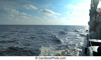 View from cargo ship deck to open sea. vessel is sailing...