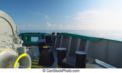 View from cargo ship deck to open sea. vessel is sailing -...
