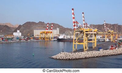 view from cruise ship sailing to seaport of Muscat, Oman