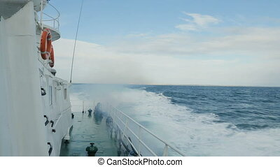 View from deck of ship as waves are splashing - View from...
