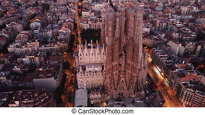 Aerial panorama view of Barcelona city skyline and Sagrada familia at dusk time