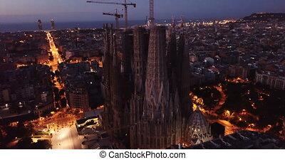 Barcelona, Spain - June 13, 2019: Aerial panorama view of Barcelona city skyline and Sagrada familia at dusk time