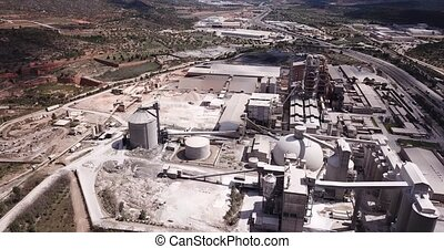 View from drone of cement plant industrial area, Bunol, ...