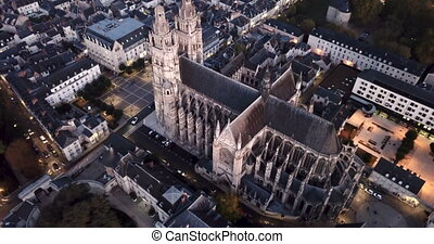 View from drone of impressive Roman Catholic Cathedral of Tours in twilight, France. High quality 4k footage