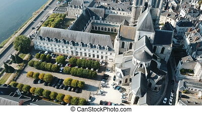 View from drone of Medieval Eglise Saint-Nicolas, St. Nicolas church, built in 12th century in Blois, France