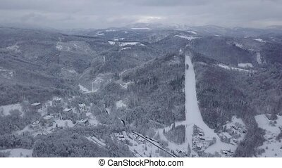 View from drone of snowy mountains - Aerial view of white...