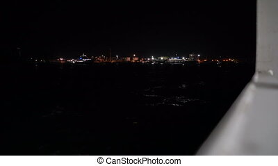 View from ferry boat lights of port Kavkaz at night crossing Kerch strait