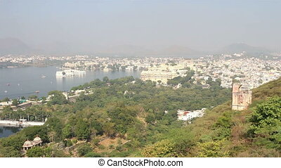 view from funicular on lake and palaces in Udaipur India -...