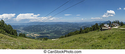 View from gondola top station on mountain Petzen to valley...