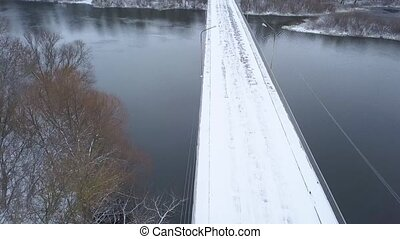 View from height to the bridge over the river in winter