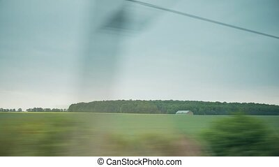 View from high speed train window - View from moving train...