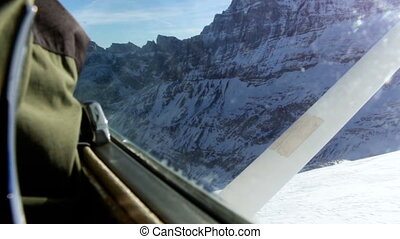 View from insde of airplane of taking off runway on glacier