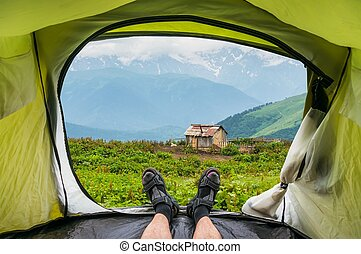 View from inside a tent on the old shack and mountains