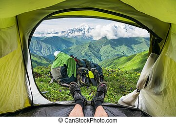 View from inside a tent on the snow-capped mountains