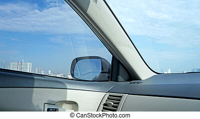 View from inside of car with blue sky background