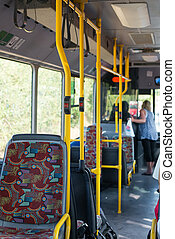 View from inside the city bus with passengers.