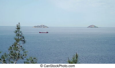 View from island on sea, ships
