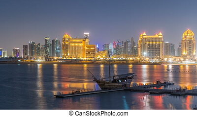 View from Katara Beach day to night timelapse in Doha,...