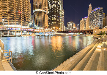 Marina Cove toward riverside Chicago skylines and State Street at blue hour