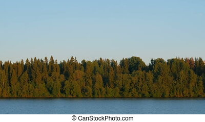 View from moving cruise ship - View on riverside of Volga...