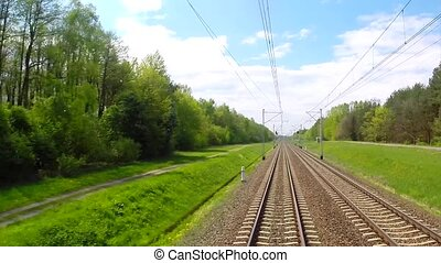 View from moving train of railway