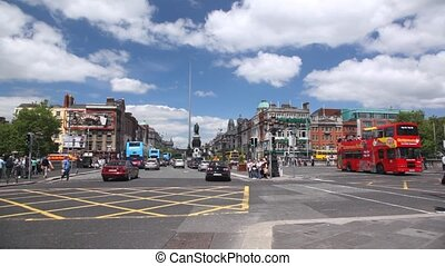 View from O'Connell Bridge on street with heavy vehicle traffic