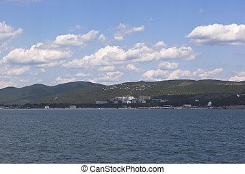 View from of the sea on resort settlement Divnomorskoe in Gelendzhik district of Krasnodar region