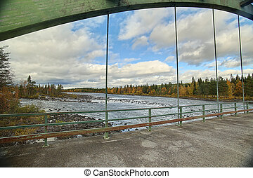 View from old bridge crossing Pite river at Ljusselforsen in Lapland