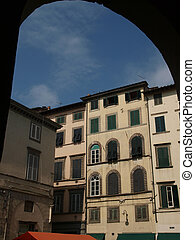 View from piazza Anfiteatro, former a Roman Ampitheatre, in Lucca. Tuscany, Italy. This square was built on the fundations of a Roman amphiteater built in the second half of the first century a. D. La