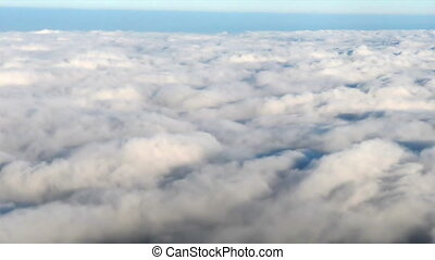 View from plane on the clouds