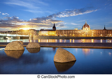 View from Rhone river in Lyon city at sunset, France.