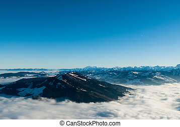 view over swiss alps from the rigi mountain in winter