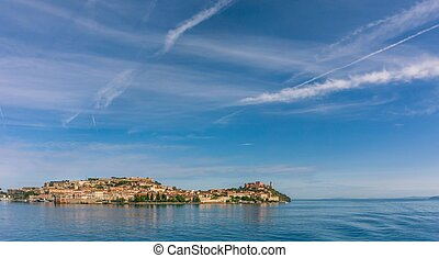 View from sea on port town on Elba Island
