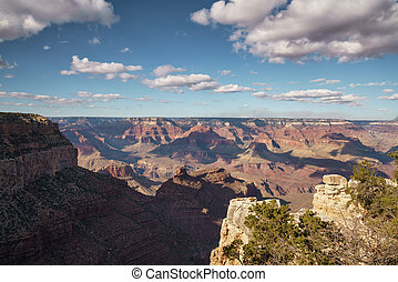 view from South Rim of Grand Canyon in sunny autumn day with white clouds