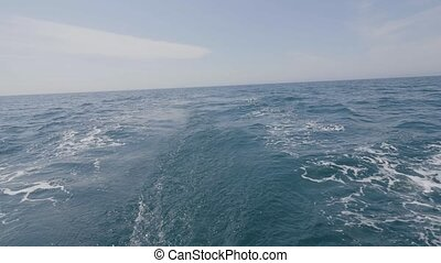 View from stern ship on back to sea waves, splash and foam...