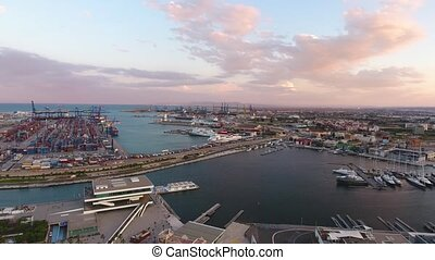 View from the air to the seaport of Valencia during sunset....