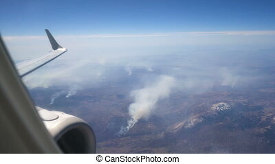 view from the aircraft on fires in the mountains